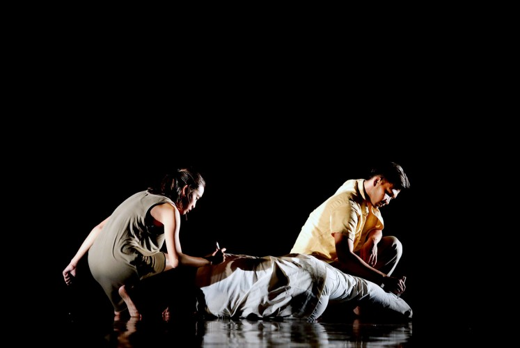 In the dark: Indonesian Dance Theater performs a theatrical dance titled 'A Walk at Pedestrian.' Created by choreographer Josh Marcy Putra Pattiwael, the dance takes inspiration from a poem by WS Rendra titled 'Sajak Orang Miskin' (Poetry of the Poor).