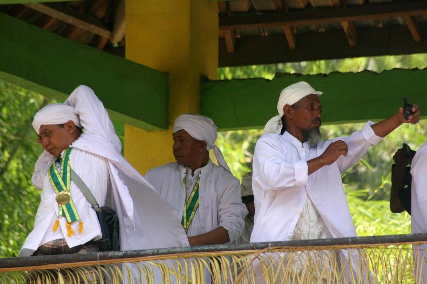 Stretching out: Local clerics get ready to distribute apem (traditional rice pancakes) to thousands of participants in Jatinom, Klaten, Central Java. JP/ Maksum Nur Fauzan