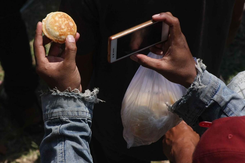 Tasty memory: A participant takes a snapshot of an apem. JP/Maksum Nur Fauzan