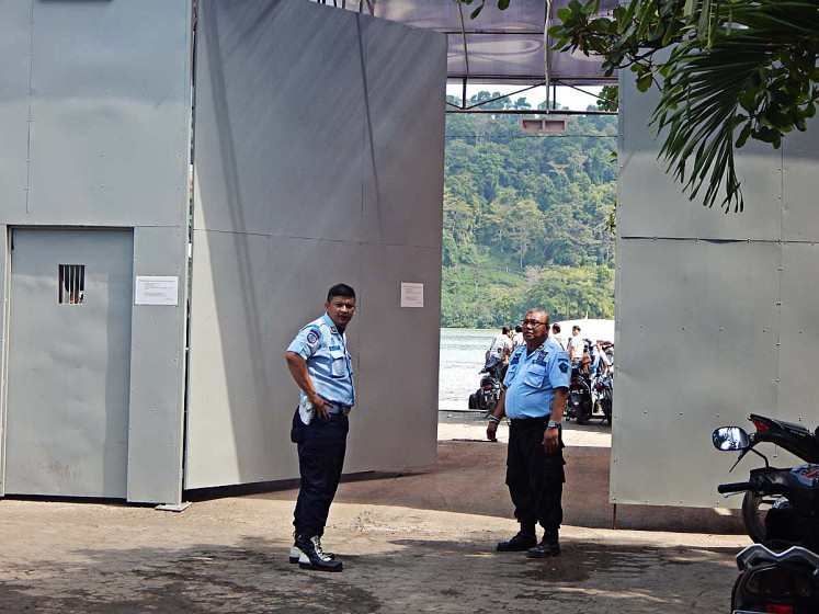 On alert: Security guards step up their measures  after a deadly clash between inmates convicted of terrorism and supporters of John Kei erupted on the Nusakambangan prison island on Nov. 7.