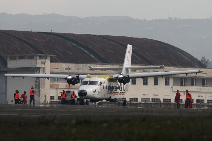 Airworthy: The N-219 aircraft lands on the runway at Husein Sastranegara Air Force Base in Bandung, West Java, after it undergoes a flying test on Aug.16.