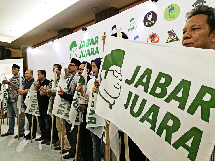 Show of support: Supporters of Ridwan Kamil join Relawan Jawa Barat Juara on Sunday to launch a crowdfunding scheme to support the Bandung mayor's gubernatorial campaign for the 2018 election.