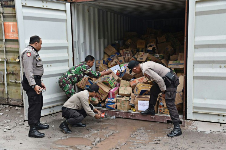In crisis: Police and military personnel unload on Sunday food packages that will be delivered to residents in Banti and Kimbely villages in Tembagapura, Mimika, Papua, who have been taken hostage by Free Papua Movement (OPM) members.
