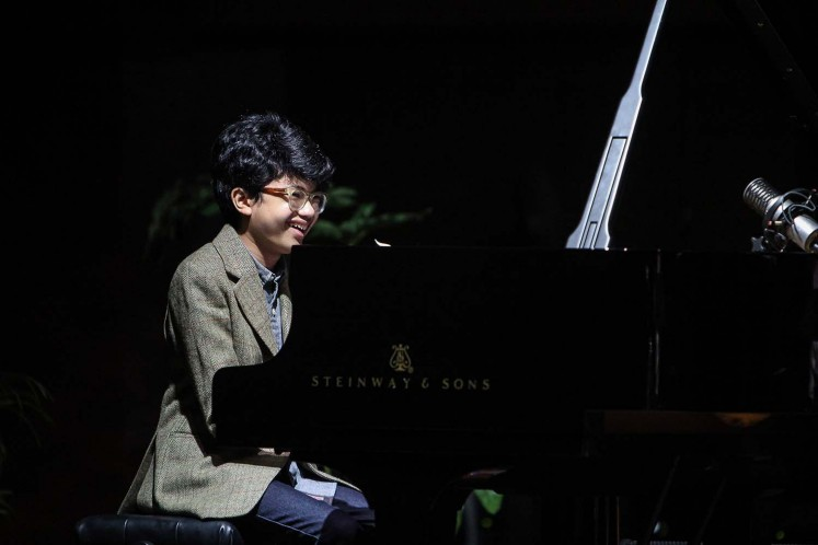 Mesmerizing: Young Indonesian pianist and 2016 Grammy Awards nominee Joey Alexander performs at the Tourism Ministry in Jakarta on Sunday. Jakarta is the final destination of his concert tour 'A Night of a Million Imaginations,' after Japan, Singapore and Hong Kong.