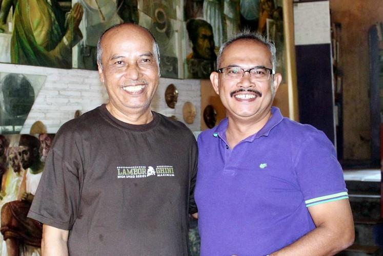Good friends: Artist Slamet 'Henkus' Hendro Kusumo (left) and collector Edwin Koamesah.