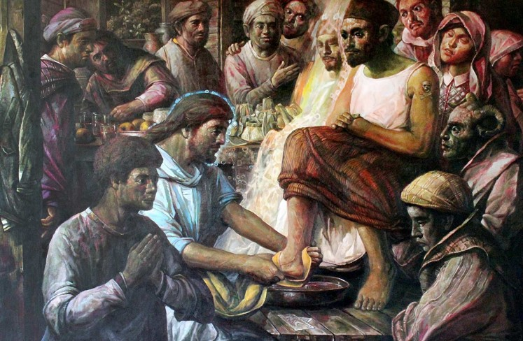 Jesus washes a disciple's feet by Slamet Hendro Kusumo