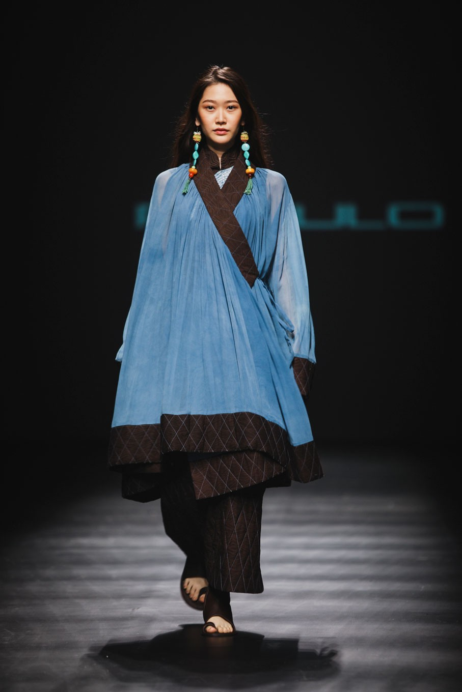 The garments play with contrasting themes, between mountains and water, man and woman, nature and mankind.