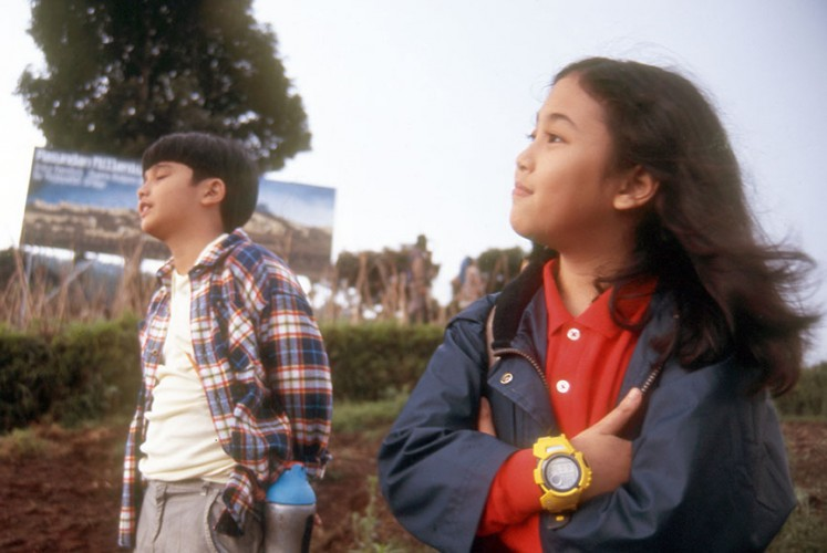 Derby Romero as Sadam (left) and Sherina as Sherina (right) in 'Petualangan Sherina' (2000).