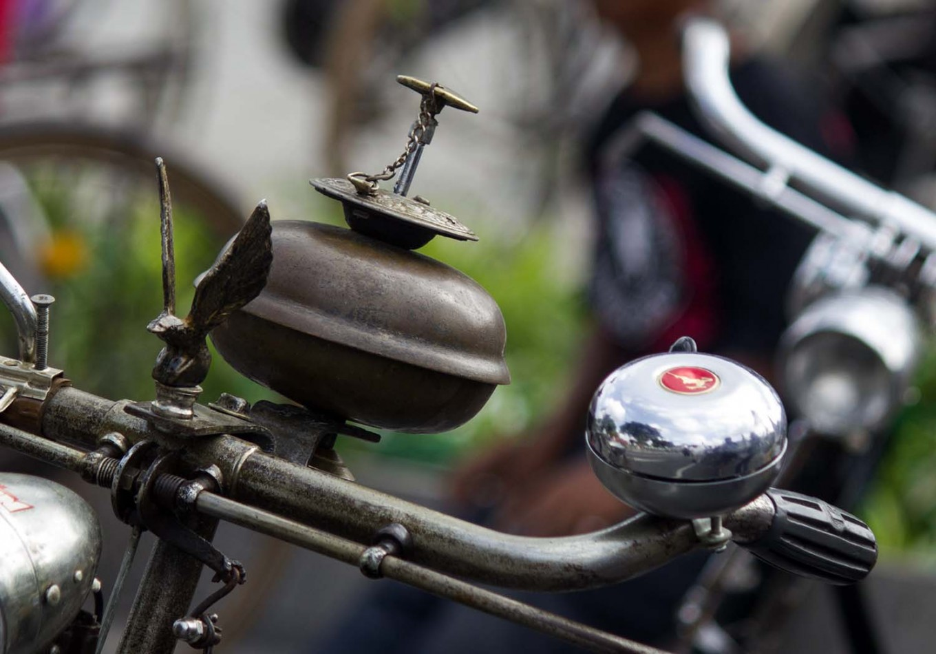 Two bells take center stage on a bicycle's handlebar. JP/Tarko Sudiarno