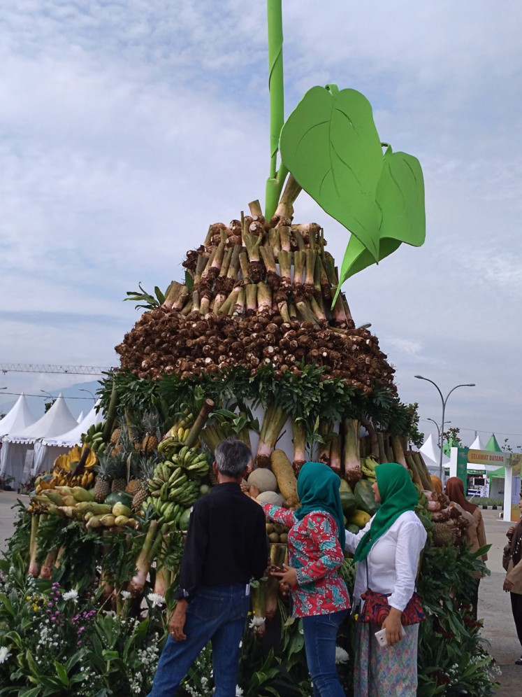 Good harvest: Visitors inspect various agricultural products displayed during an exhibition at Pakansari Sports Stadium in Cibinong, Bogor regency, West Java.