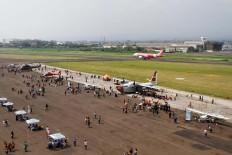 An Air Asia airplane crosses behind the tarmac used for the Bandung Air Show.  JP/Arya Dipa