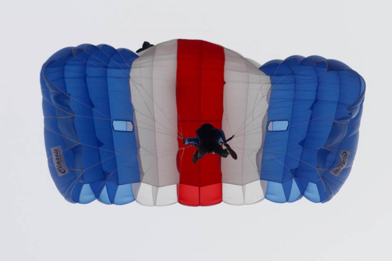 A parachuter flies over the Air Force base during the Air Show. JP/Arya Dipa