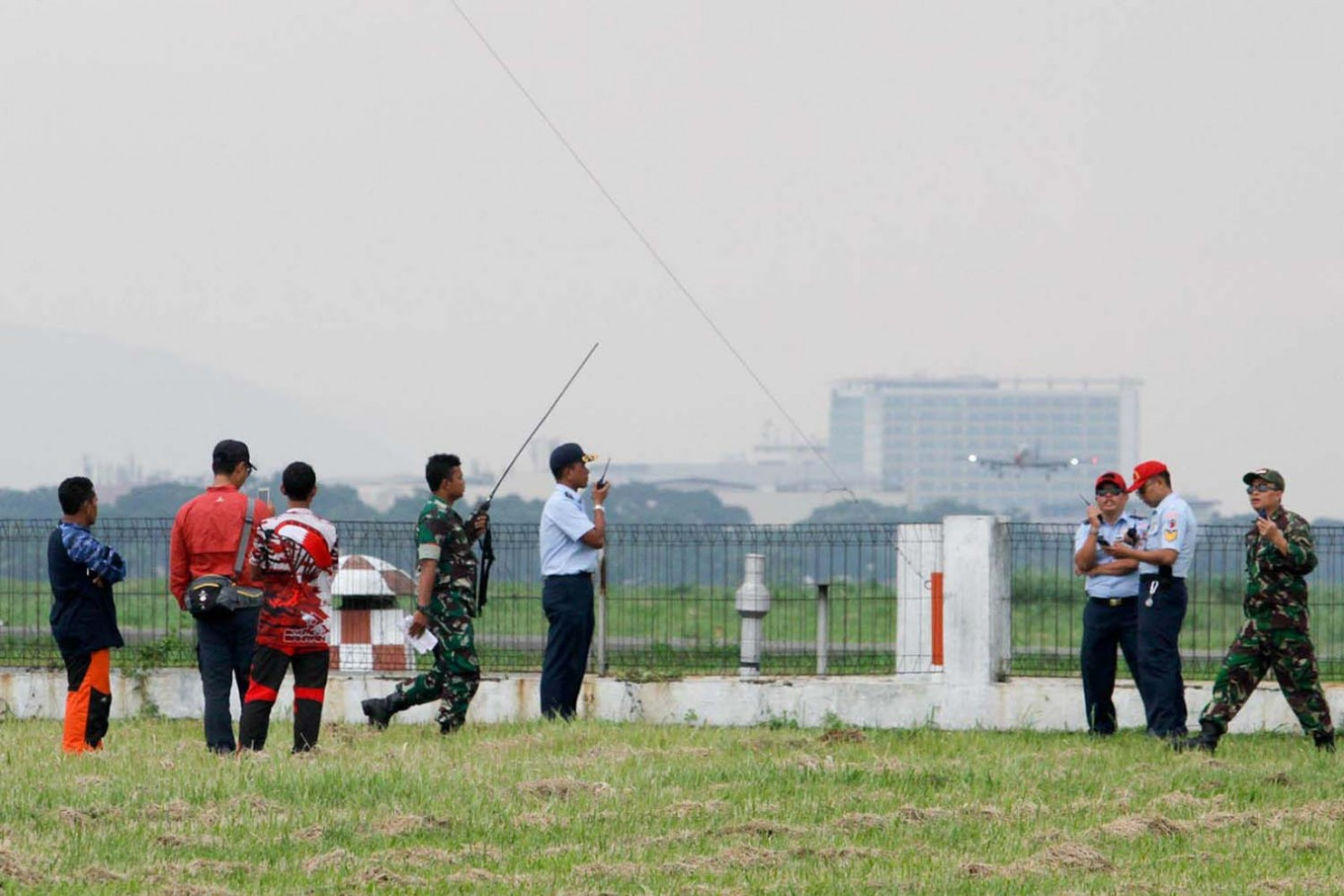 Some Air Force officers communicate with the ATC (Air Traffic Control) to assure the show is safe. JP/Arya Dipa