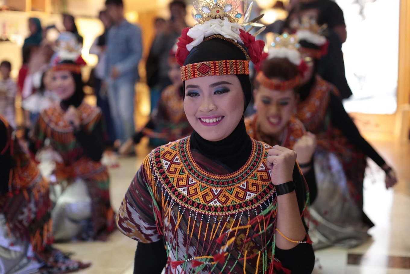 One of the participants smiles during Indonesia Menari 2017. Taking place in Grand Indonesia mall on Sunday, participants are encouraged to dance to a compilation of traditional Indonesian songs.