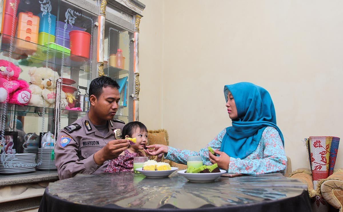 Before duty: Wahyudin spends time with his family during breakfast. JP/Bangkit Jaya Putra