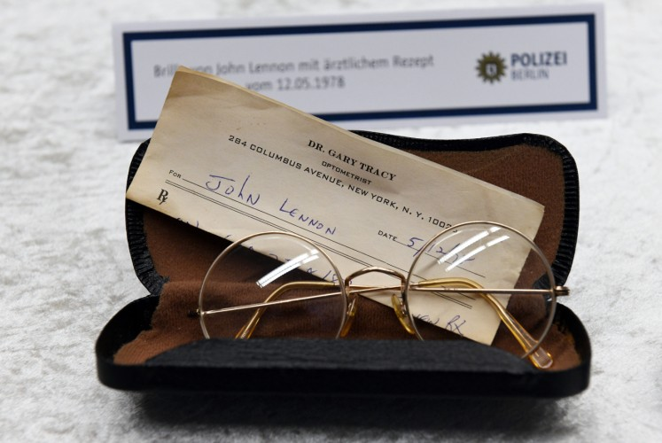 Glasses from the estate of John Lennon are pictured during a press conference on November 21, 2017 in Berlin. German police on November 20, 2017 had arrested a 58-year-old man in Berlin on suspicion of handling the stolen items, including the late Beatle's diaries. The items were stolen from Lennon's widow Yoko Ono in New York in 2006.