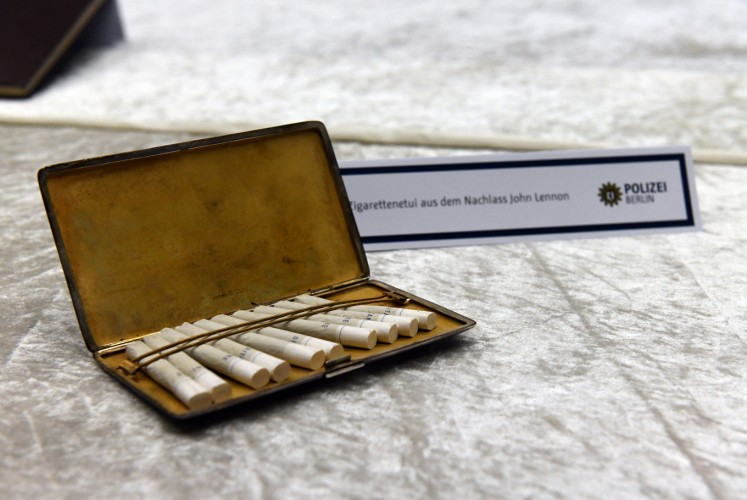 A cigarette case from the estate of John Lennon is pictured during a press conference on November 21, 2017 in Berlin. German police on November 20, 2017 had arrested a 58-year-old man in Berlin on suspicion of handling the stolen items, including the late Beatle's diaries. The items were stolen from Lennon's widow Yoko Ono in New York in 2006.