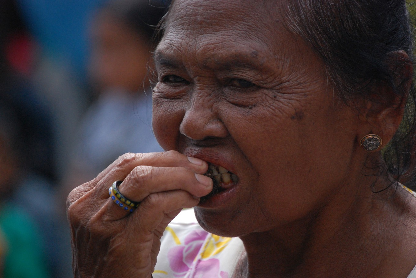 A woman is seen chewing 'kinang' at the gamelan performance in Kasunanan Palace in Surakarta on Friday.
