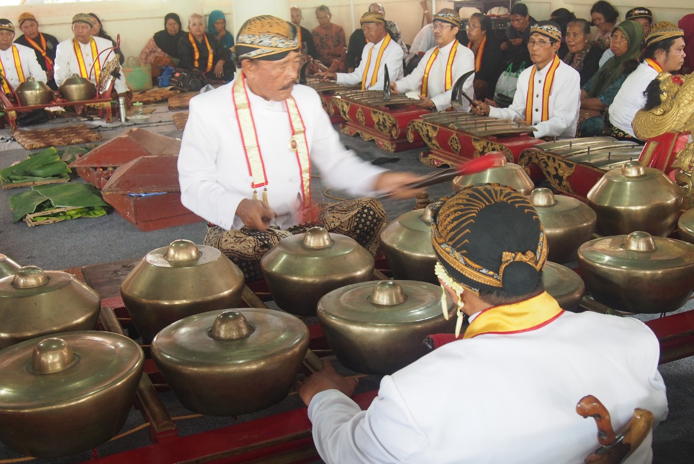 Royal servants play Sekaten gamelan as part of a ceremony which commemorates the birthday of the Prophet Muhammad at the Grand mosque, Surakarta in Central Java on Friday.