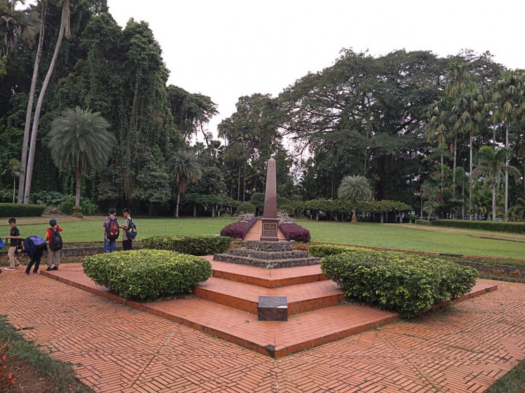Unique landmark: Visitors enjoy the beauty of Teysman Park at the Bogor Botanical Gardens on Nov.25.