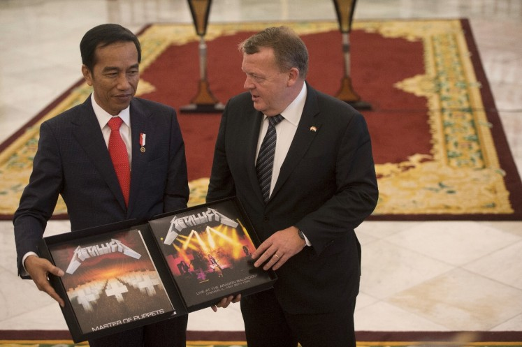 "Danish Prime Minister Lars Lokke Rasmussen and President Joko ""Jokowi"" Widodo pose with the two LPs in the limited-edition boxed set of Metallica's 'Master of Puppets' on Nov. 28, 2017 at Bogor Palace. 'Master of Puppets' is considered Metallica's seminal album, selling over 10 million copies around the world and becoming the first metal album to be listed in the US Library of Congress."