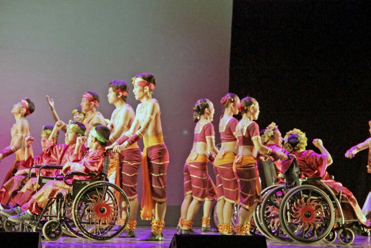 Roll with it: Performers from the Jakarta Disabled Children's Foundation (YPAC) join forces with EKI Dance Company for a powerful performance.