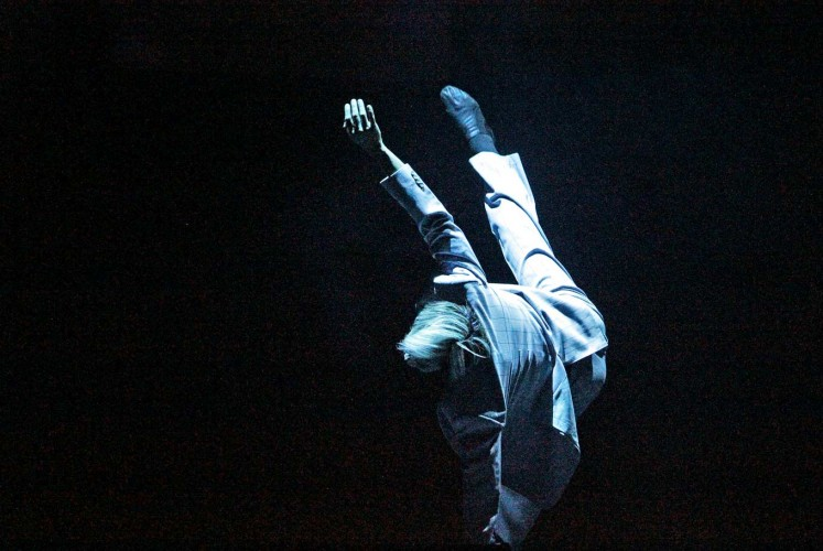 In the air: A member of the EKI Dance Company tumbles and sways his way through a performance.