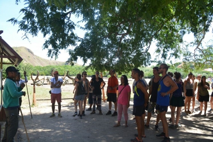 Safety first: A ranger (left) gives safety instructions to tourists visiting Rinca Island in West Manggarai regency, East Nusa Tenggara.