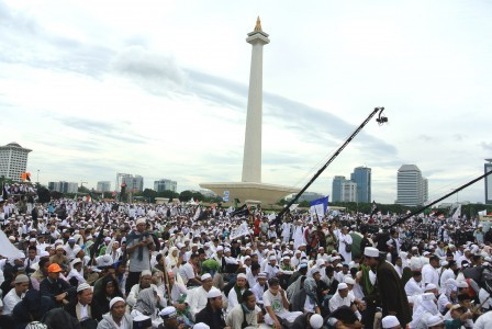 Participants of 212 reunion rally gather to pray and conduct religious activities in the Monas Park on Saturday, Dec. 2. They come Monas to commemorate the large-scale rally held last year seeking the imprisonment of former Jakarta Governor Basuki