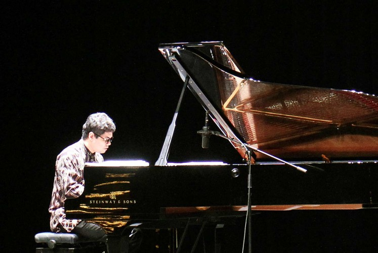 Fusion play: Indonesian pianist Ananda Sukarlan plays his composition 'I Wish Pavarotti Had Met Marzuki' during a recent tribute concert honoring legendary Italian opera singer Luciano Pavarotti.