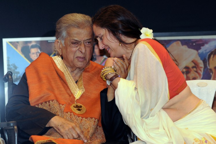 This file photo taken on May 10, 2015 shows Indian veteran Bollywood actor Shashi Kapoor (L) and his daughter Sanjana Kapoor interacting during the presentation of the 'Dadasaheb Phalke Award' for his contribution to Indian cinema at Prithvi Theater in Mumbai. Bollywood icon Shashi Kapoor -- a star of 1970s Indian cinema and a member of the Hindi film industry's famous Kapoor family -- died on December 4 aged 79 after a long illness, his family said.