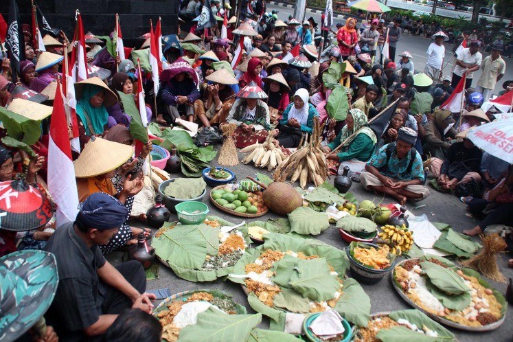 Making their voices heard: Hundreds of farmers from North Kendeng Mountain in Central Java voice their concern over PT Semen Indonesia's plan to build a cement factory in Pati regency.