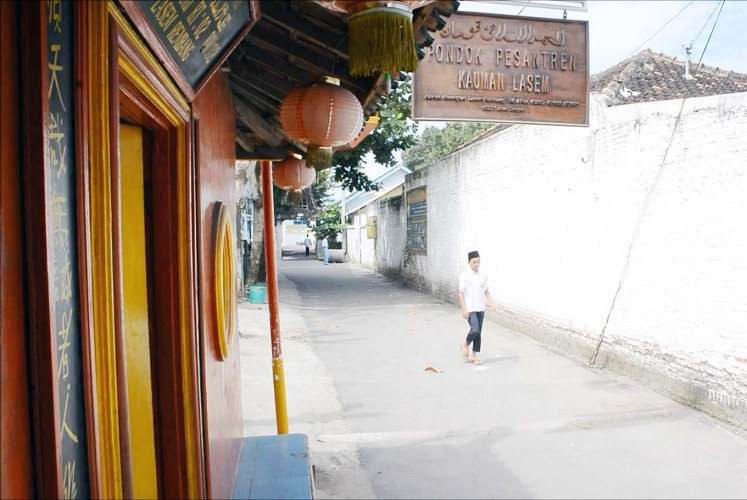 Best of both worlds: A student enters the gate of the Kauman Islamic Boarding School which features Chinese traditional lanterns.