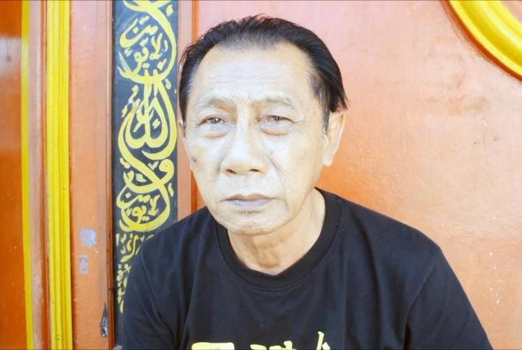 Neighborhood unit chief Kristianto heads the Chinese neighborhood in which Kauman Islamic Boarding School operates.