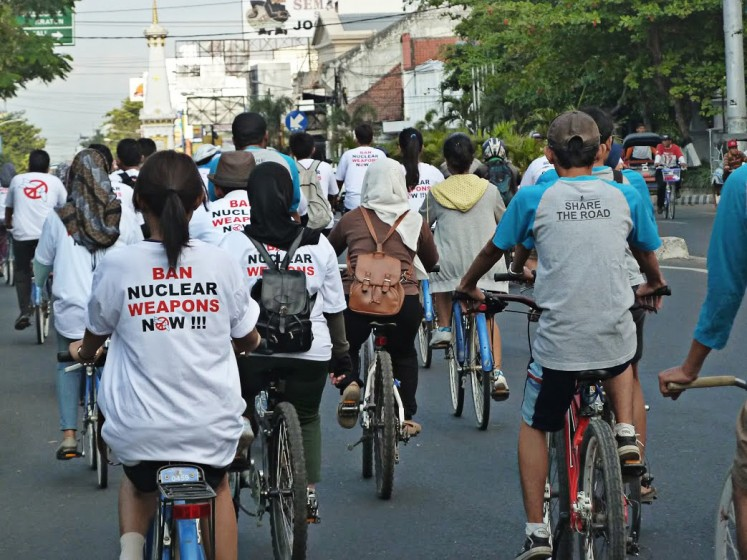 Promoting peace: Gadjah Mada University activists hold a cycling event in Yogyakarta recently to campaign for the prohibition of nuclear weapons.