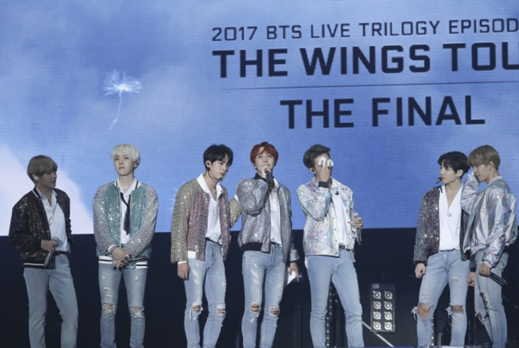 """After leaving their footprints around the globe, BTS finally landed on its home turf, where it put an end mark on its monthslong """"Wings"""" tour that kicked off in Seoul in February."""