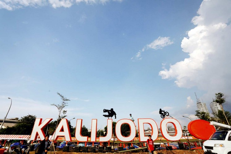 New face: Kalijodo is currently home to a large skate park for children, and on weekends, market stalls sell food and drinks to families.