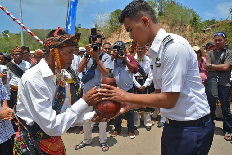 Blessings: An elder from a customary village welcomes Resto during a traditional ceremony held for his naming as the youngest pilot in Kampung Mbrata, West Manggarai, East Nusa Tenggara.