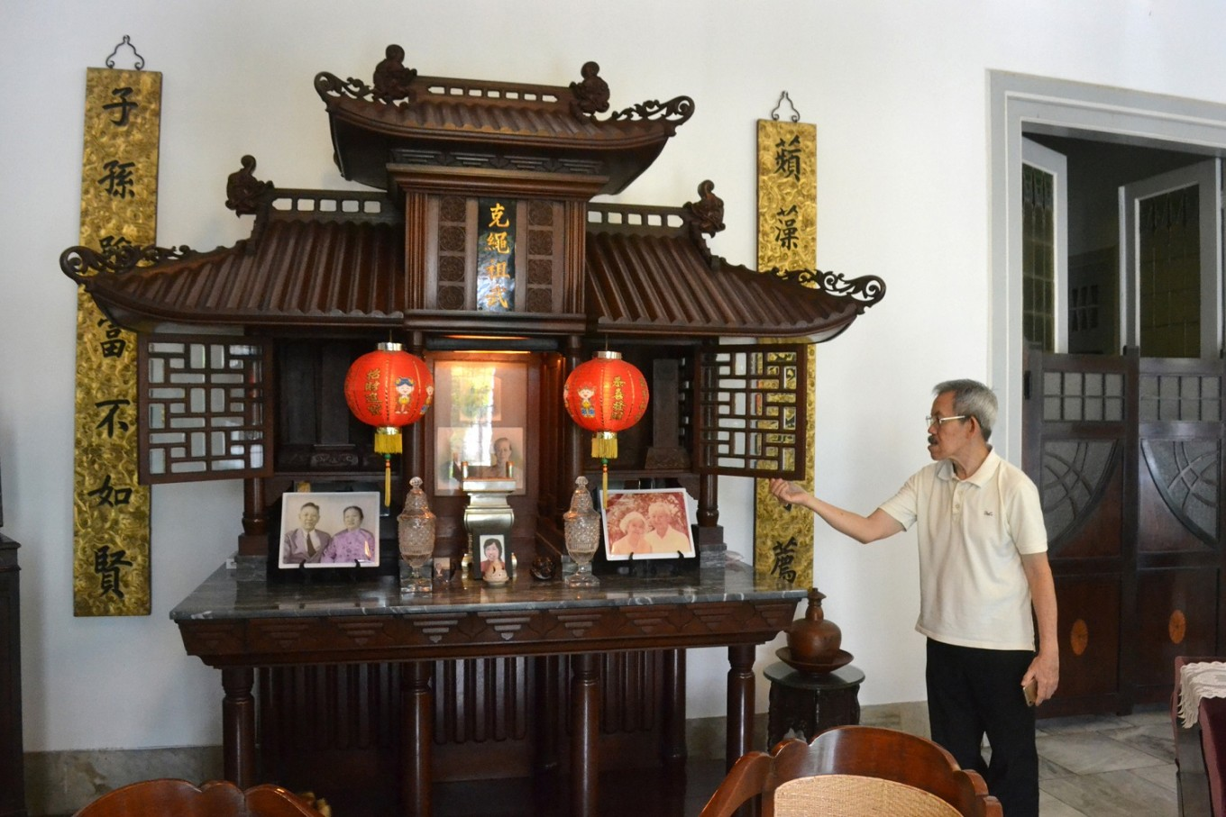Basuki showcases the family altar. An Indonesian of Chinese descent, his ancestors came from Fujian, China.