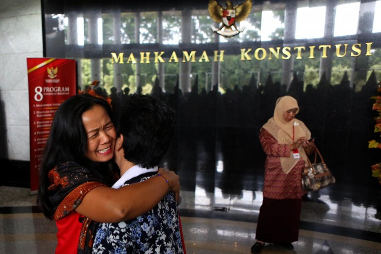 A women's rights activist cries with joy after the Constitutional Court (MK) rejected a judicial review petition demanding that articles on adultery in the prevailing Criminal Code be expanded to include pre-marital sex and same-sex relationships in this Dec. 14, 2017, file photo.