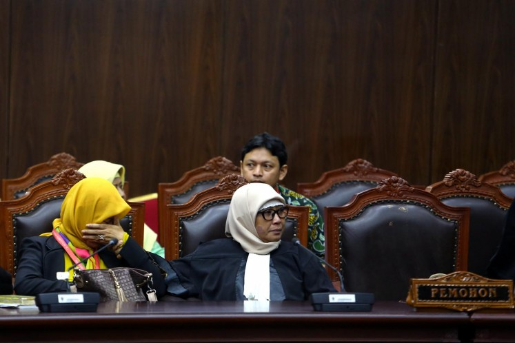 Fighting for rights: Evi Risna Yanti (left), the lawyer of 12 individuals who sought to ban premarital sex and same-sex relationships through a judicial review petition against the Criminal Code bill at the Constitutional Court, weeps after the court rejects their petition in a hearing in December in 2017.