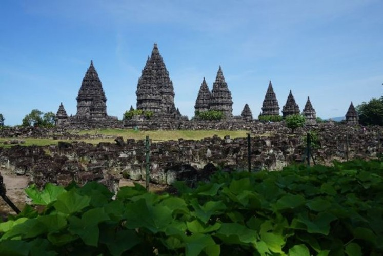 The Prambanan Temple compound, with piles of rocks indicating temples still left for reconstruction