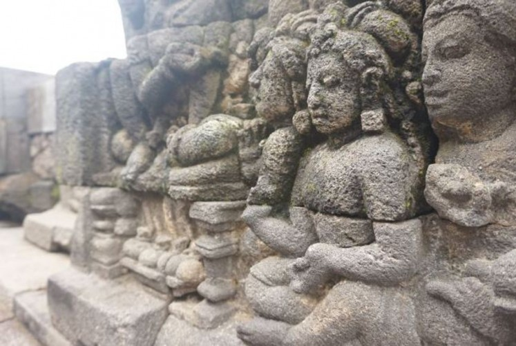 Reliefs along the walls of Borobudur Temple