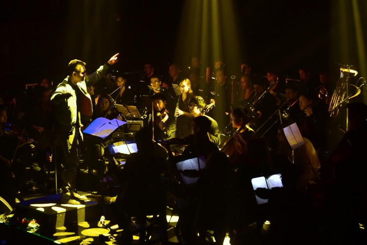 Yuga Cohler, Music Director of the Young Musicians Foundation (YMF) Debut Chamber Orchestra leads the orchestra during a performance of Yeethoven II in Los Angeles, California on December 14, 2017.