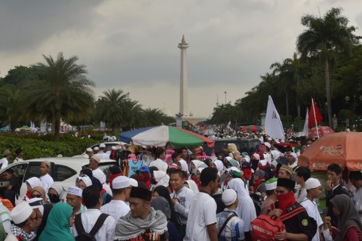 Indonesians gather ahead of a protest against US President Donald Trump's recent decision to recognise Jerusalem as the capital city of Israel, at the US embassy in Jakarta on Dec. 17, 2017. Thousands attended the rally organised by the country's top Islamic authority, the Indonesian Ulema Council (MUI), backed by the government as well as several other Islamic organisations.