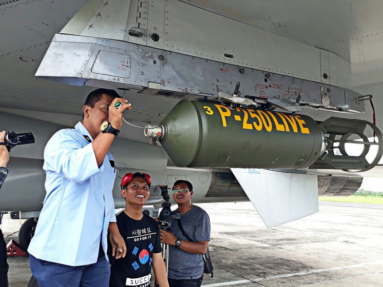 Getting prepared: A technician at Iswahjudi Air Force Base in Madiun, East Java, checks a P-250 Live bomb ahead of a bomb test at the Air Force Base on Dec.15.