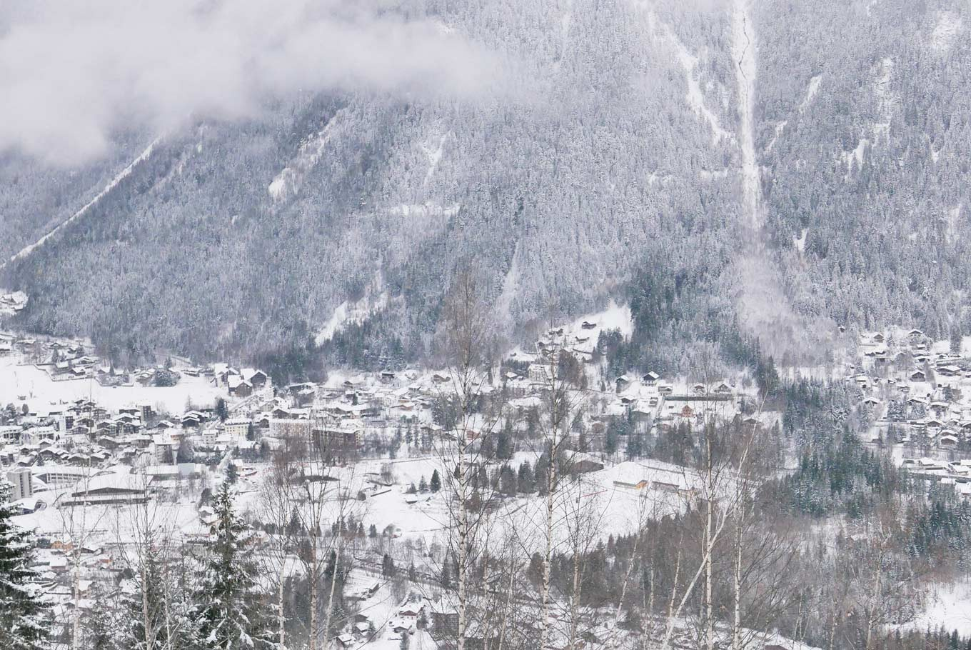 The snow-blanketed valley city of Chamonix Mont-Blanc, seen from the Red Train ride to Montenvers.