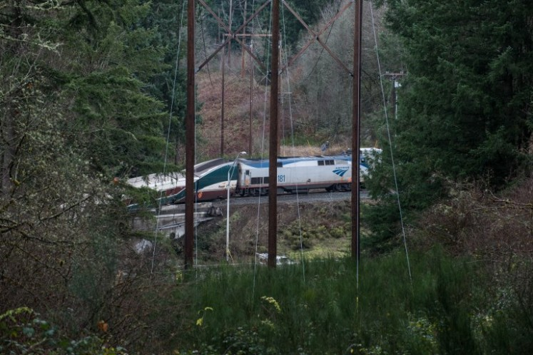 The scene after an Amtrak high speed train derailled from an overpass early Dec. 18, 2017 near the city of Tacoma, Washington state.
