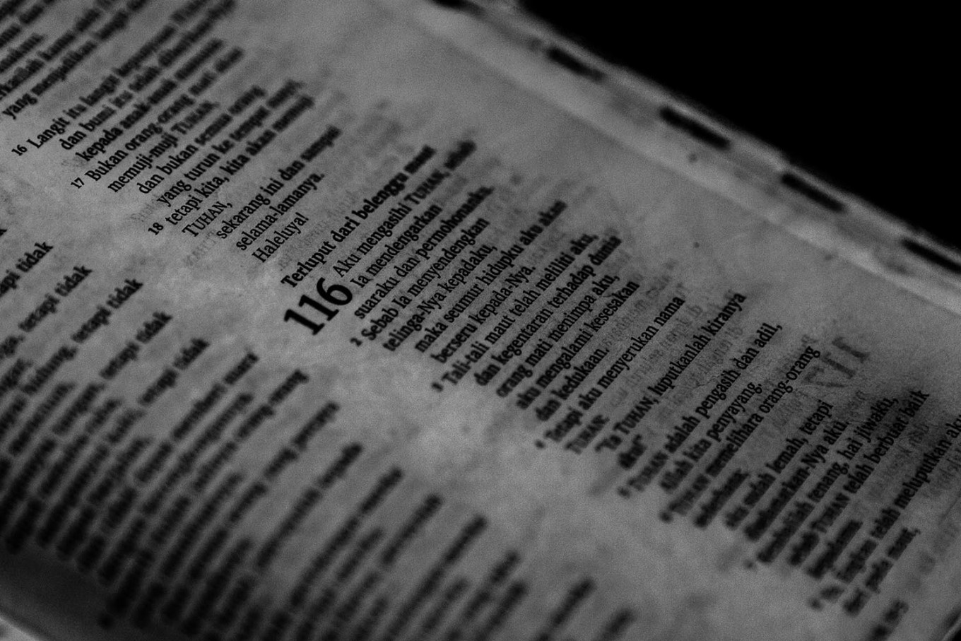 Calling to the Lord: A resident reads from the Book of Psalms in the Bible. JP/Seto Wardhana