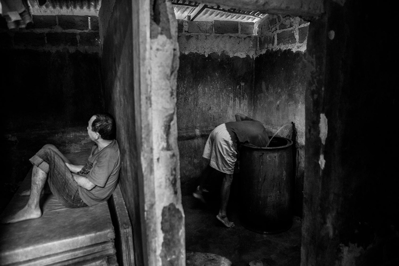 Daily life: Two residents are seen going about their day's activities. JP/Seto Wardhana